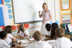 a-teacher-teaching-a-junior-school-class_BYeezSCRHi