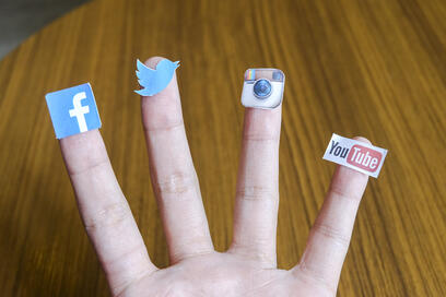 chiang-mai-thailand-september-24-2014-social-media-brands-printed-on-sticker-and-placed-on-human-finger-include-facebook-twitter-instagram-and-youtube_SDkxuHed2Mx