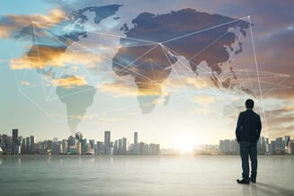 graphicstock-international-business-concept-with-businessman-on-city-skyline-background-with-network-on-map-and-sunlight_rOFam3Dxjl